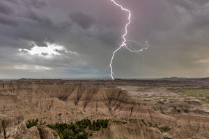 Lightning strike during thunderstorm from the Pinnacles Overlook in Badlands National Park