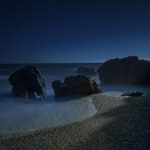 Long exposure of sunlight on beach and rocks on northern California coastline