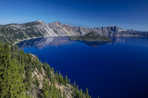 Looking down on blue waters of Crater Lake in Crater Lake National Park, Oregon, USA