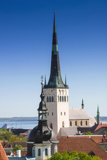 Medieval town walls and spire of St. Olav church, view of Tallinn from Toompea hill