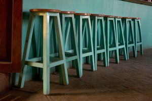 Mexico, Oaxaca, Green Bar Stools line wall inside Roof Top Cafe near the Iglesia