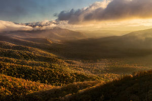 Misty autumn sunrise and Blue Ridge Mountains from Blue Ridge Parkway from Pounding