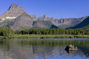 Mountains reflected in Lake. Glacier National Park. Montana. USA