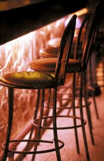 North America, Mexico, Quintana Roo, Playa del Carmen. Barstools in pink light