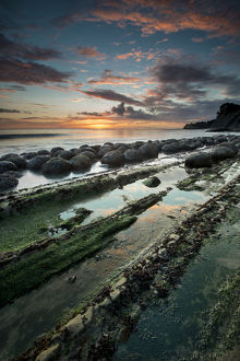 North America, USA, California. Sunset on the emerging rocks at Bowling Ball Beach