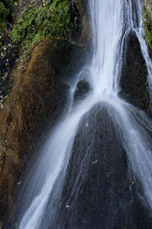 North America, USA, California. Waterfall over boulders at Darwin Spring, Death