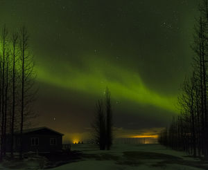 Northern Lights or aurora borealis over Laugardalur during winter in Iceland. europe