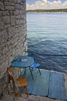 Oceanside seating for two at tiny outdoor cafe, Rovigno, Croatia