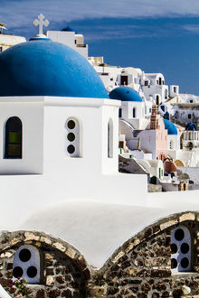 europe/greece/oia greece row greek orthdox churches blue domes
