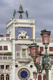 europe/italy/old lamppost clock tower venice italy