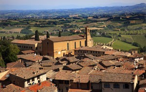 europe/italy/old tuscan town church red brick roofs countryside