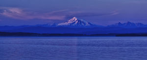 Orcas Island, USA - Mt. Baker and the Cascade Range backdrop the Puget Sound at dusk