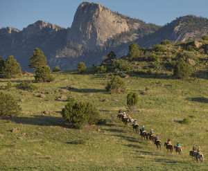 Philmont Cavalcades ride horses through the rugged mountain wilderness like the famous