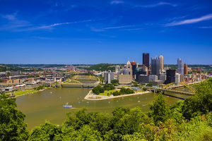 Pittsburgh, Pennsylvania. Aerial view of the city with rivers, bridges, and boats