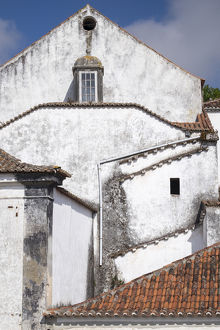 Portugal, Obidos. Ancient, red, terra cotta tiled roof tops, lines