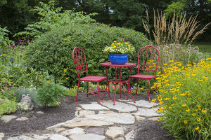 Red table & chairs with blue pot in flower garden. Marion Co., IL (PR)