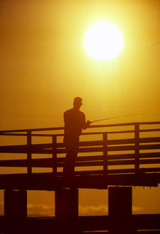 places/silhouette man fishing pier