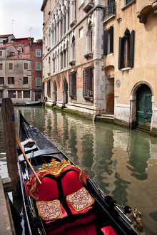 europe/italy/small canal bridge buildings gondola boats reflections