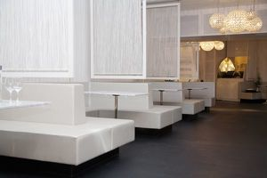 Stockholm, Sweden - Bench style booth seating in a restaurant. The tables, seating