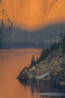 Sunset colors the waters at Crater Lake National Park, Oregon, USA