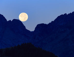 Super moon setting over the Grand Teton Mountain Range, Grand Teton National Park