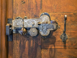 Switzerland, Bern Canton, Spiez, Spiez Castle, wood door with ornate hardware