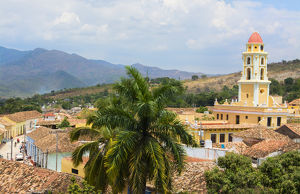 Trinidad Cuba from above tower with church and mountains with buildings of tile roofs