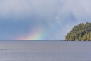 US, AK, Ketchikan, Rainbow glow on horizon Tongass Narrows Inside Passage near Settlers