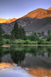 USA, California, Bishop. Sunrise on mountain lake