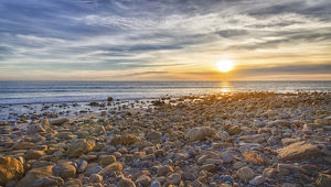 USA, California, Malibu. Sunset as seen from County Line Beach, on the border of