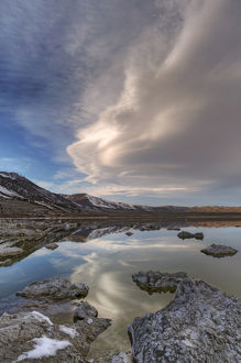 USA, California, Mono Lake. Lenticular cloud reflects in lake