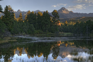 USA, Colorado. Mt. Sneffels reflects in beaver pond