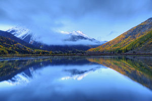 USA, Colorado, San Juan Mountains. Sunrise on mountain and Crystal Lake. Credit as