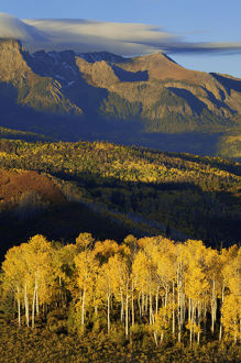 USA, Colorado, San Juan Mountains. Sunrise on mountain and valley landscape. Credit as