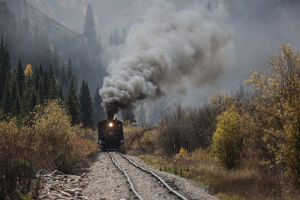 USA, Colorado, Silverton. Durango & Silverton Narrow Gauge train climbs grade. Credit as