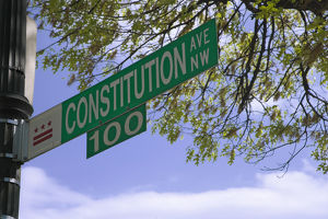USA, Washington, D.C. Close-up of historic Constitution Ave. street sign. Credit as