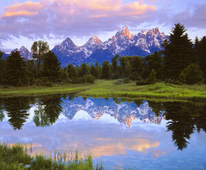 USA; Wyoming, Grand Teton National Park. A  Grand Tetons reflecting in the Snake River