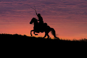 USA, Wyoming, Shell, The Hideout Ranch, Silhouette of Cowboy and Horse at Sunset (MR/PR)