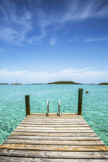 caribbean/exuma/vertical photo dock foreground clear water blue