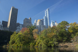 View of highrise buildings along Central Park South from inside Central Park on a