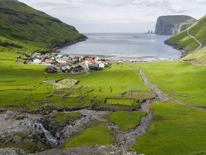 Village Tjornuvik. In the background the island Eysturoy with the iconic sea stacks Risin