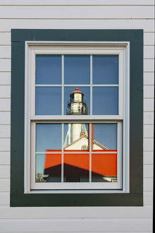 Whitefish Point Lighthouse reflected in window, the oldest operating light on Lake